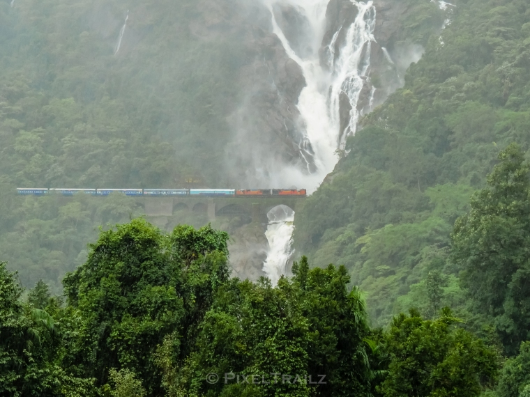 Amaravati Express getting a shower as it glides past Dudhsagar Waterfalls